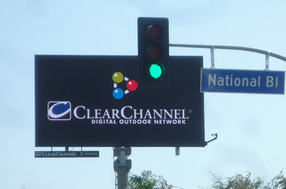 Photo taken from inside car at intersection.  Billboard was deemed a traffic hazard by LADOT, but is still operating.