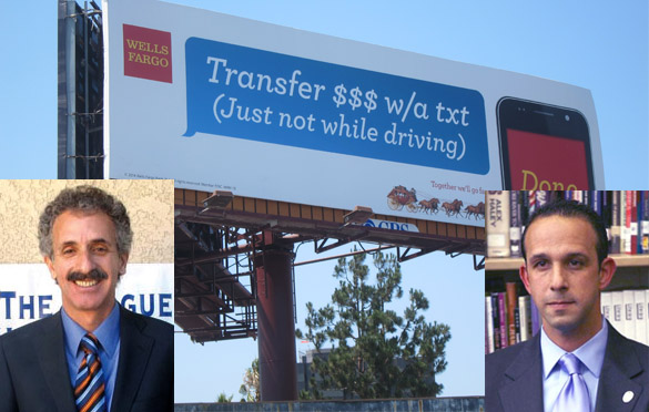 City Attorney Mike Feuer, left; City Councilman Mitchell Englander, right.  CBS Outdoor billboard in background has no city permit on file.